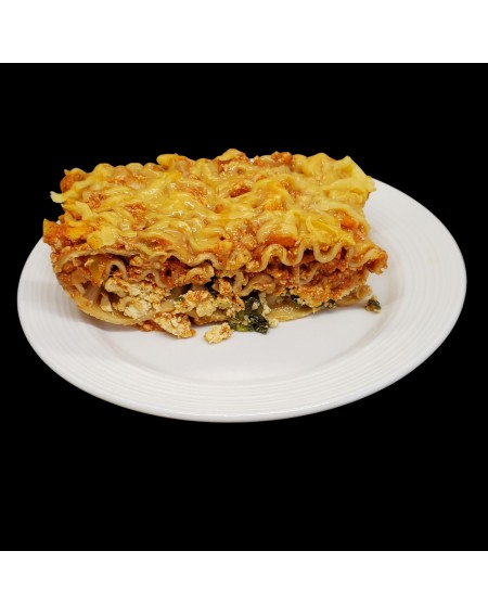 lasagna is filled with vegetables and fake meats, vegan ricotta and spinach layer
